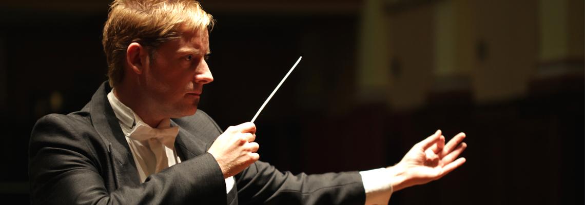 Andrew conducting